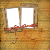 Old grunge frames with ribbons and bow o — Stock Photo