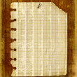 Old notebook sheet attached to wooden wa — Stock Photo