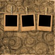 Royalty-Free Stock Photo: Old photoframes are hanging in the row o