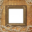 Wooden frame with beads on the leafage o — Foto de Stock