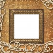 Wooden frame with beads on the leafage o — Stock Photo