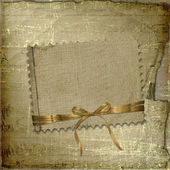 Grunge paper with ribbon and bow on the — Stock Photo