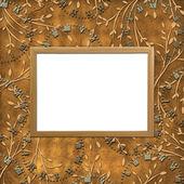 Moldura de madeira sobre o b de folhagem ornamental — Foto Stock