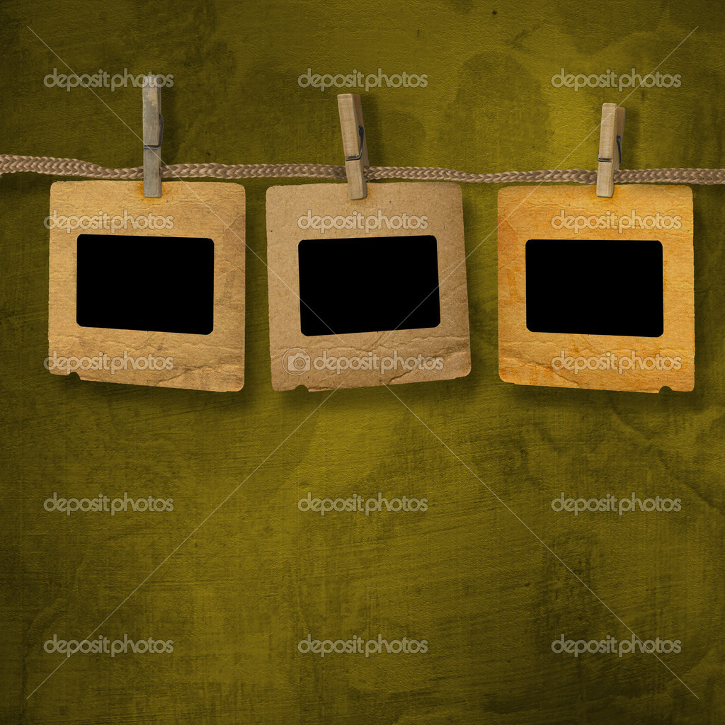 Old photoframes are hanging in the row on the abstract background — Stock Photo #1144284