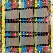 A striped scratch background with films — Stock Photo