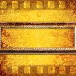 Royalty-Free Stock Photo: Old filmstrip on the paper background