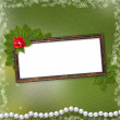 Frame for photo with pearls and bunch of flower — Stock Photo