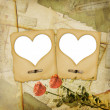 Old grunge paper frame with heart - Stockfoto