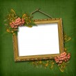 Picture gold frame with bunch — Stock Photo