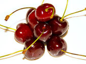 Red cherries on plate — Stock Photo