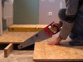 Carpenter sawing — Stock Photo