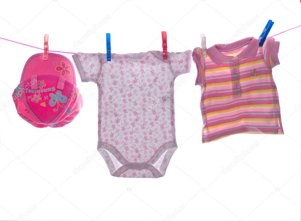 Baby clothes hang on clothesline — Stock Photo #1287788