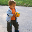 Walking baby with ball in his hands — Stock Photo