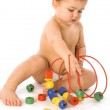 Boy playing with cubes and curl — Stock Photo