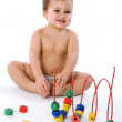 Boy sitting and laughing near his toys — Stock Photo #1131630