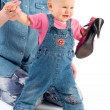 Smiling baby with shoe — Stock Photo