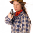 Smiling cowgirl with gun aim at someone — Stock Photo