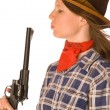 Cowgirl blowing to her gun after shoot — Stock Photo