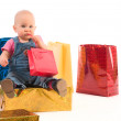 Baby girl opening gifts — Stock Photo