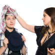 Woman fiting dress to another woman isol — Stock Photo