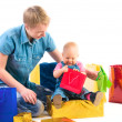 Baby and mother with gifts — Stock Photo