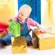 Baby opening gift - Stock Photo