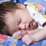 Sleeping baby blanketed — Stock Photo