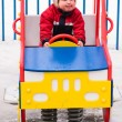 Winter boy on playground — Stock Photo