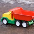 Baby toy dump truck in dirt — Stock Photo #1133149