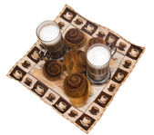 Home-made cinnamon snail bakery with lat — Stock Photo
