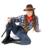 Cowgirl with gun sitting and glares down — Stock Photo