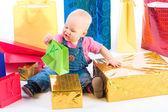 Baby opening gift — Stock Photo