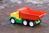 Baby toy dump truck in dirt — Stock Photo