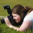 Woman-photographer with camer aiming at — Stock Photo