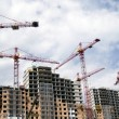 building crane and building under constr — Stock Photo