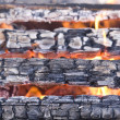 Scorched wood in flame - Stock Photo
