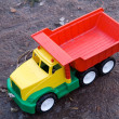 Baby toy dump truck in dirt — Stock Photo #1144461