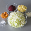 Cuted potato, onion, beet, carrot and ca - Stock Photo