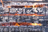 Scorched wood in flame — Stock Photo
