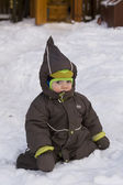 Baby sitting in snow — Stock Photo