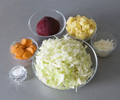Cuted potato, onion, beet, carrot and ca — Stock Photo