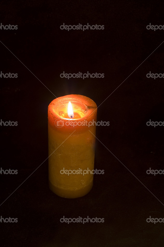 Burning candle isolated on black — Stock Photo #1144415