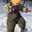 winter baby stap against snow forest — Stock Photo