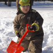 Baby with red shovel — Stock Photo