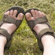 Tired sandalled feet — Stock Photo