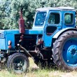 Blue tractor - Stock Photo