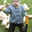 Surprised boy with wood chopper — Stock Photo