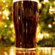 Christmas with Irish pint of black beer — Stock Photo