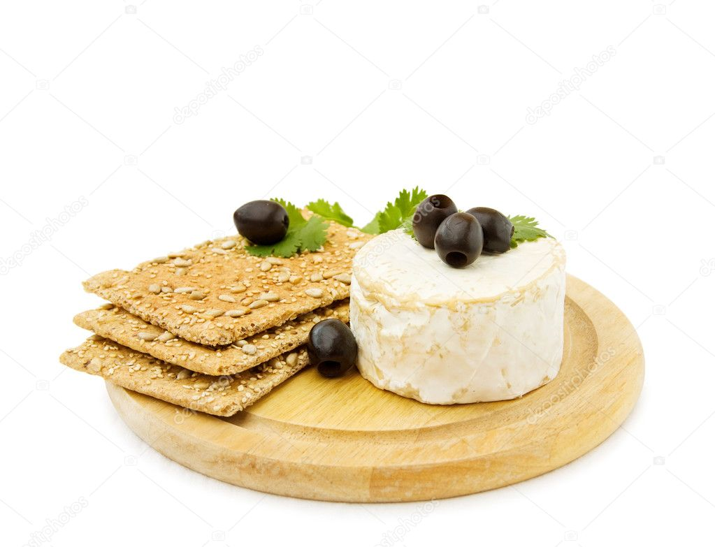 Healthy snacks with Brie cheese, organic crackers and olives. Isolated on white background.  — Stock Photo #1156579