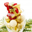 Christmas gift and golden baubles — Stock Photo